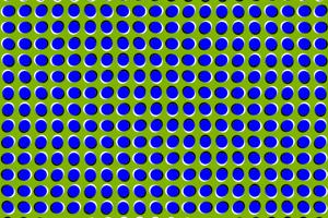 Ilúzia statického pohybu. Klam vzniká vďaka rozdielnemu nasmerovaniu čiernobieleho okraja modrých bodiek a kontrastným farbám.