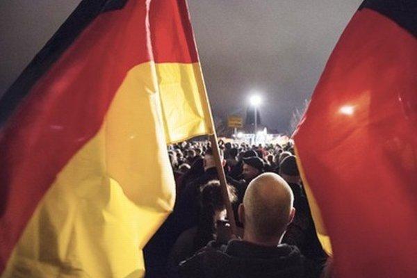 Na proteste v Drážďanoch.