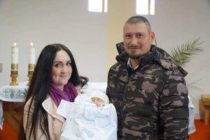 Pri krste s oboma rodičmi.