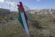 Protestný plagát na hraniciach medzi Izraelom a Palestínou.