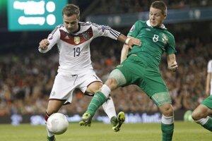 Götze (vľavo) pobudol na ihrisku v poslednom kvalifikačnom zápase len niečo vyše polhodinu.