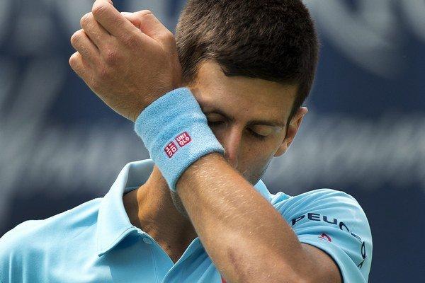 Novak Djokovič ovládol US Open v roku 2011. Teraz bude na turnaji chýbať jeho najväčší rival Rafael Nadal.