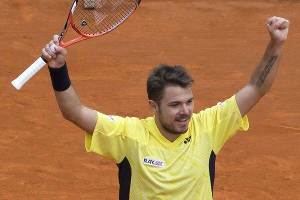 Švajčiarsky tenista Stanislas Wawrinka sa raduje z víťazstva nad Španielom Davidom Ferrerom v semifinále.