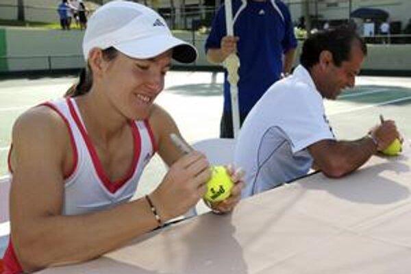 Justine Heninová (vľavo) a jej tréner Carlos Rodriguez.
