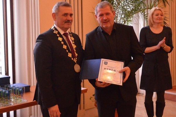 Martin Melník sViliamom Zahorčákom. Tréner úspešného družstva starších žiakov MFK Zemplín.