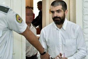 Na snímke Jaromír Ruda eskortovaný z pojednávacej miestnosti.