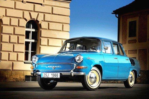 Text: Škoda 1000 MB debutovala v roku 1964. Embéčka bola prvá škodovka s novou koncepciou hnacej sústavy - motor vzadu, pohon zadných kolies.