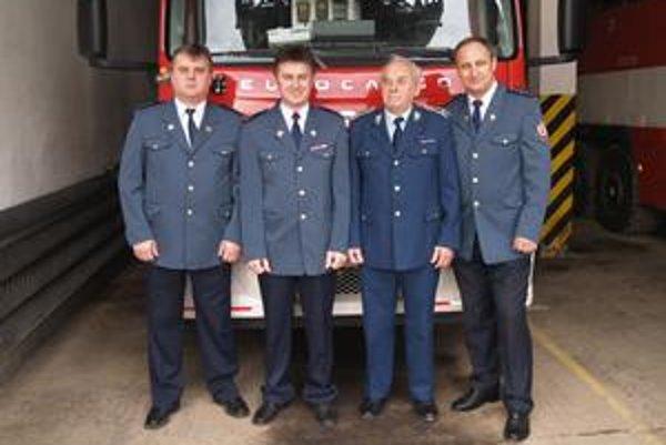 Ustrojení v uniformách - zľava Peter, Jozef, Ladislav st. a Ladislav ml.