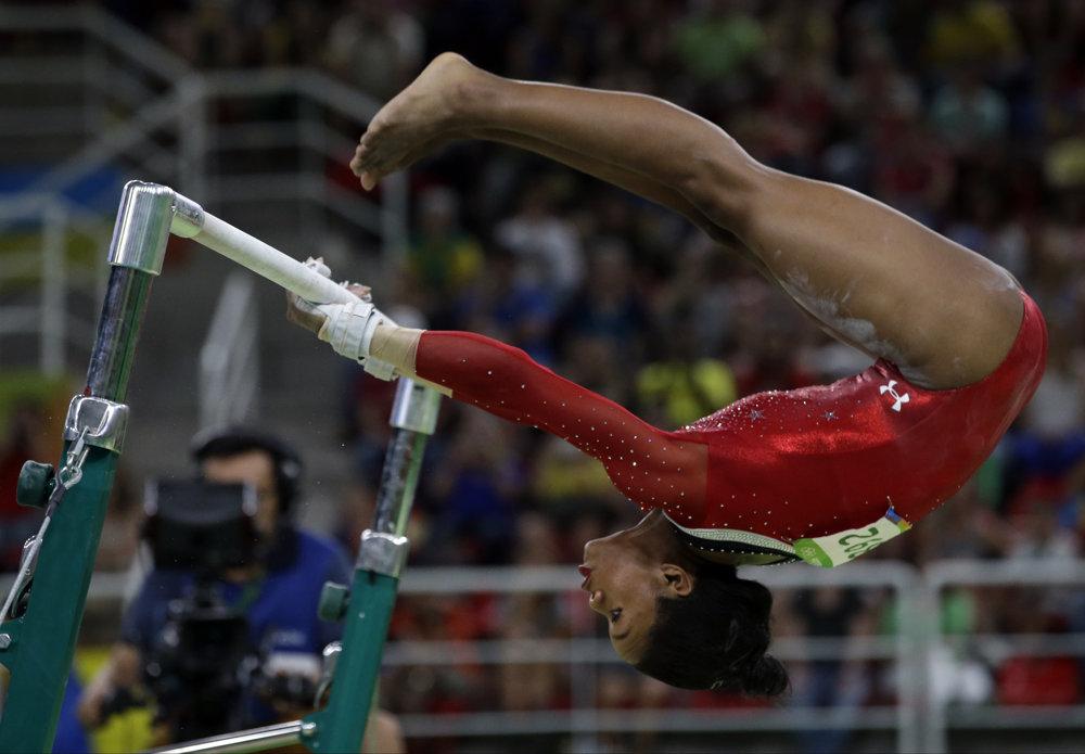 Gymnastika, Američanka Gabrielle Douglasová na bradlách.