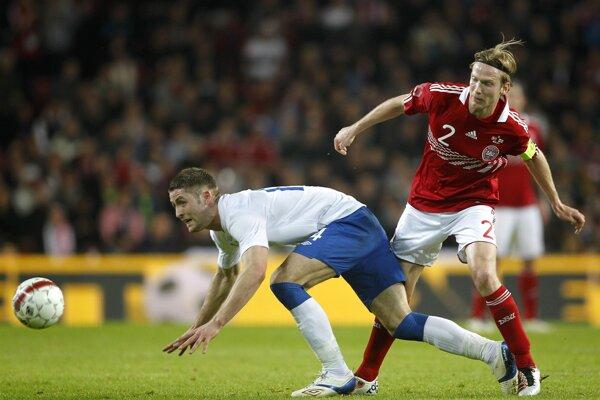 Christian Poulsen (vpravo) odohral za reprezentáciu Dánska takmer sto zápasov.