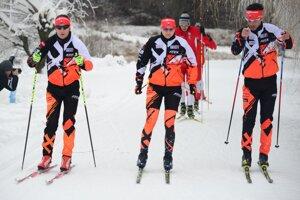 Tomáš Hasilla (na snímke vľavo) obsadil na biatlonových majstrovstvách sveta krásne 16. miesto.