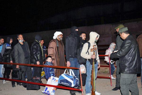 Bojovníci opúšťajú Homs.
