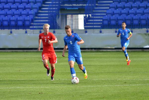 Denis Baumbgartner (pri lopte) je aj mládežníckym reprezentantom Slovenska.