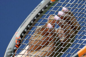 Raket a ruka Madison Keysovej.