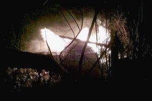 Požiar chaty.