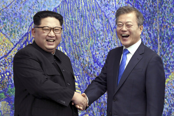 Kim Čong-un a Mu Če-in.
