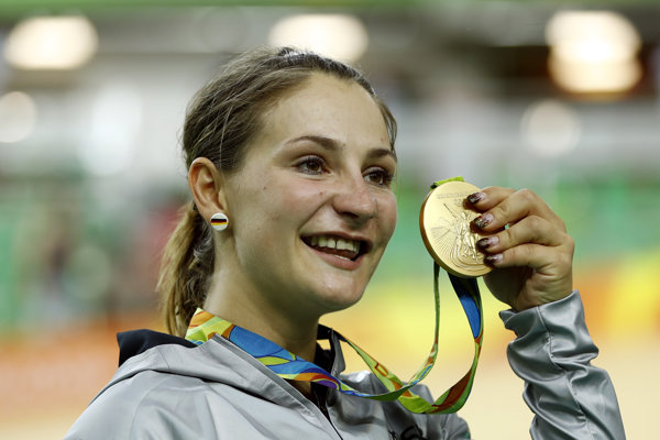Kristina Vogelová so zlatou olympijskou medailou z Ria.