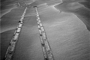 Stopy roveru Opportunity v marťanskej pôde.