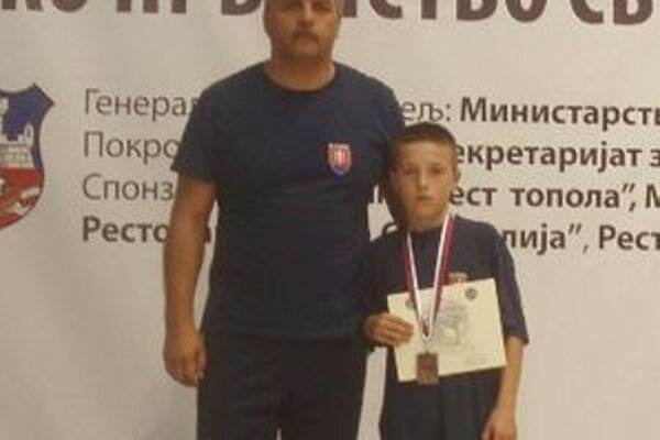 Ondrej Franek s trénerom Petrom Balážom na MS v Belehrade.