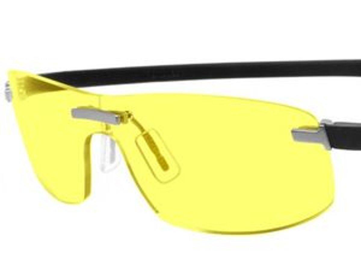 9ff2ccdba Okuliare používané pretekármi majú špecifickú žltú farbu a dioptrické sklá  korigujúce nočnú krátkozrakosť.