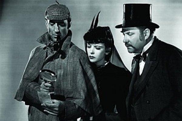 Jedným z najvýraznejších predstaviteľov Sherlocka Holmesa bol britský herec Basil Rathbone. Holmesa hral v množstve filmov a v televíznom seriáli. Dr. Watsona hral Nigel Bruce. Snímka pochádza z filmu The Adventures of Sherlock Holmes (1939) a herečka v s