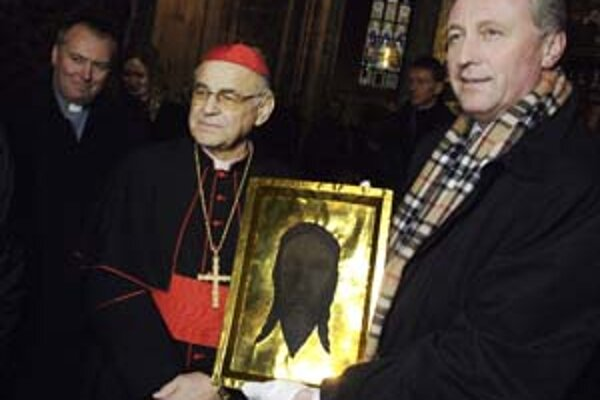 Premiér Topolánek s kardinálom Vlkom v Katedrále sv. Víta. Tá zatiaľ patrí štátu.