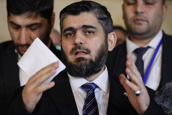 Vedúci delegácie sýrskych povstalcov na mierových rozhovoroch Muhammad Allúš.