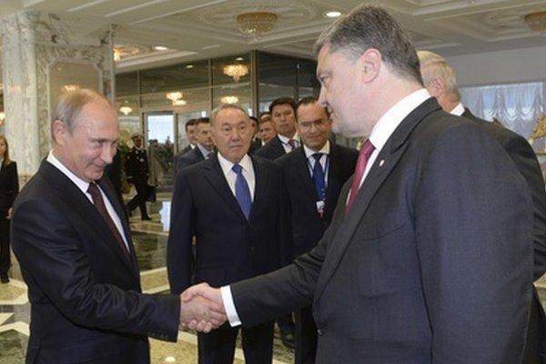Ruský prezident Vladimir Putin a ukrajinský prezident Petro Porošenko v Minsku.