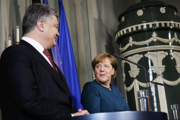 Ukrajinský prezident Petro Porošenko a nemecká kancelárka Angela Merkelová.