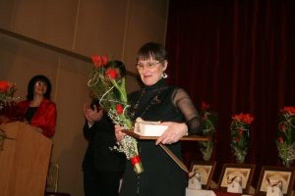 Pri preberaní ocenenia v Brezne