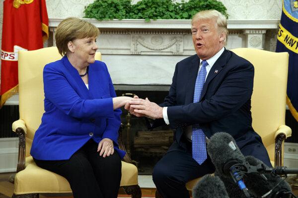 Donald Trump a Angela Merkelelová.