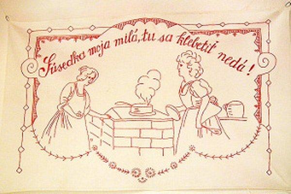 Vyšívaná kuchárka alebo nástenka s odkazom, ktorý je aktuálny aj dnes.