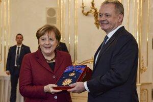 Andrej Kiska s Angelou Merkelovou v Prezidentskom paláci.