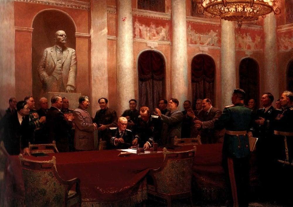 V.I.Vychtinskij: V mene mieru. Podpísanie zmluvy medzi Sovietskym zväzom a Čínou v roku 1950. Súdruhovia J.V. Stalin a Mao Ce-tung si podávajú ruky obklopení predstaviteľmi strany a štátu.