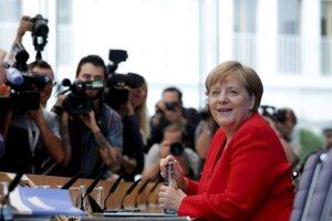 Nemecká kancelárka Angela Merkelová počas piatkovej letnej tlačovej konferencie.