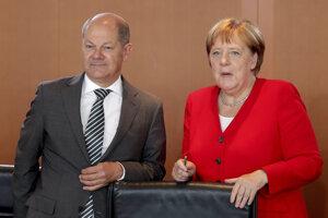 Nemecký minister financií Olof Scholz a kancelárka Angela Merkelová.