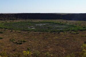 Takýto kráter Wolf Creek zanechal dopad meteoritu na zem