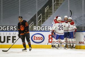 Momentka z nočného zápasu NHL Edmonton - Montreal.