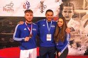 Zľava Tomáš Kósa, tréner Klaudio Farmadín a Veronika Helferová.
