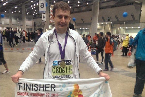 V Tokiu. Maratónec Andrej Ružík.