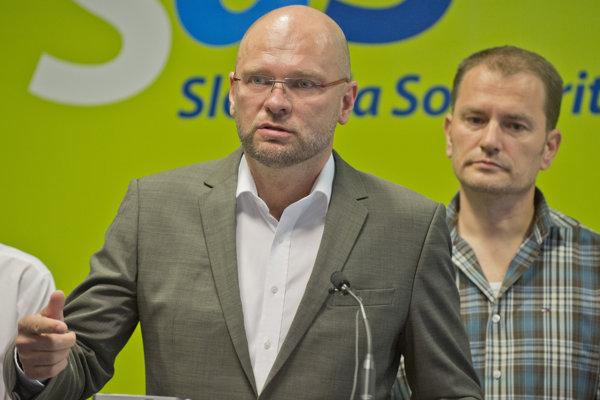 Na snímke zľava predseda SaS Richard Sulík a predseda OĽaNO-NOVA Igor Matovič.