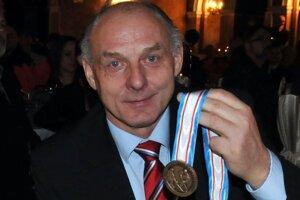 Rudolf Jurčenko s bronzovou medailou.