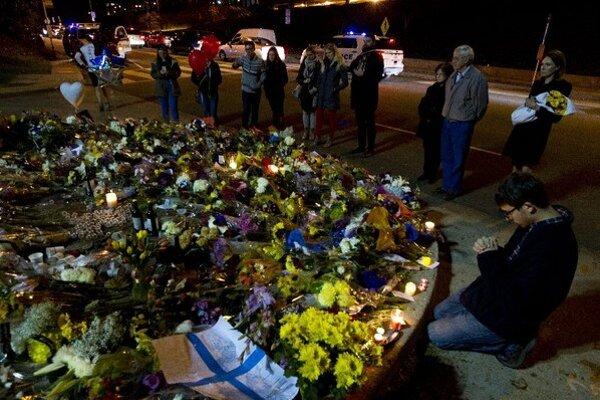 Smútiaci po teroristických útokoch v Paríži.