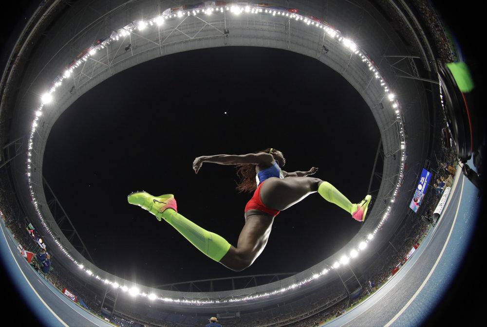 Trojskok, zlatá medailistka Caterine Ibargüenová z Kolumbie.