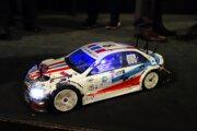 Súťažný model poznačený účasťou v pretekoch.