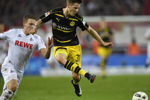Erik Durm v žlto-čiernom drese Borussie.