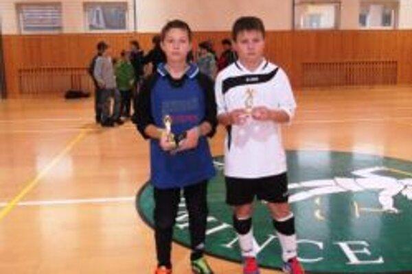 Zľava: brankár Martin Kilian a strelec Lukáš Fiala.