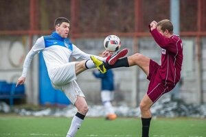 Milan Vajagič (v bielom) vsúboji oloptu.