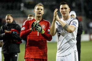 Niklas Süle (vpravo) a Manuel Neuer.