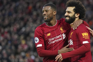 Futbalisti Liverpoolu po góle.